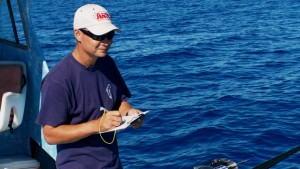 Eddie Ebisui III recording depth, location and size of tagged bottom fish